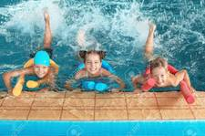 110046674 Little Kids With Swimming Noodles In Indoor Pool